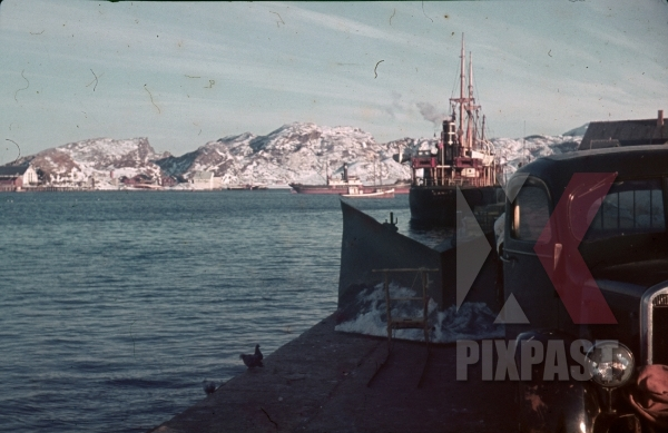 stock-photo-ww2-color-norway-1940-cargo-fishing-boats-ships-supply-harbour-snow-tractor-truck--8010.jpg