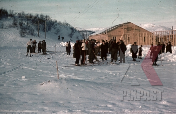 stock-photo-ww2-color-norway-1940-norwegian-civilians-snow-skiing-beside-german-military-barracks-building-site-7999.jpg