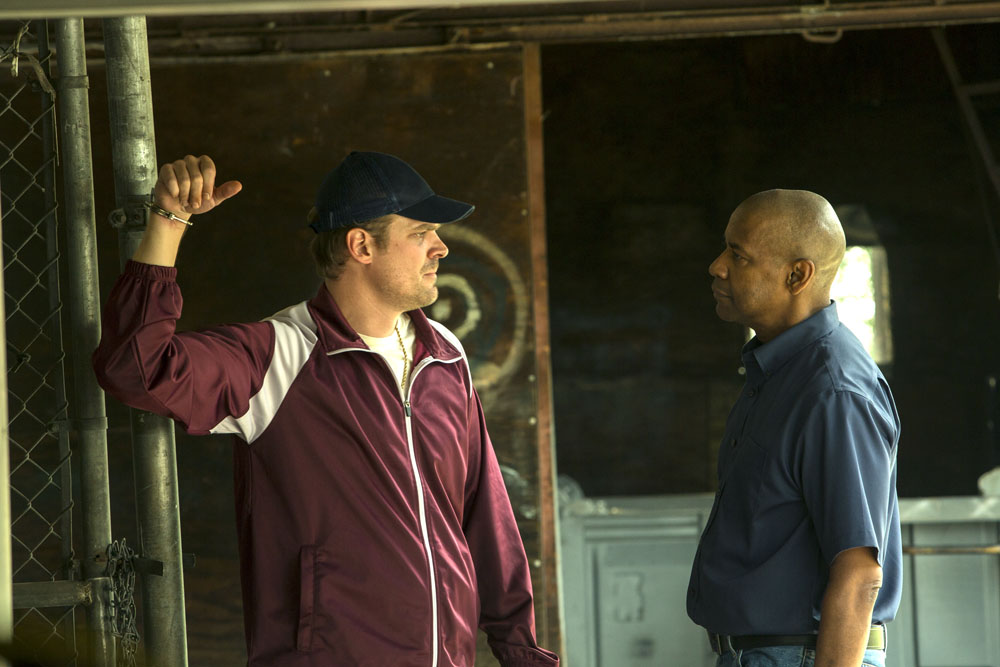 McCall (DENZEL WASHINGTON) has words with Masters (DAVID HARBOUR).in Columbia Pictures' THE EQUALIZER.