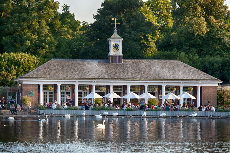 View of the cafe pavilion from the other shore in the background of birds