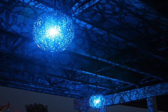 Recycled Bike Part Chandeliers Under a Texas Overpass