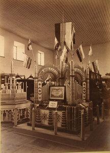 Витрина с изделиями восково-свечного завода П.А. Федосеева в фабричном отделе выставки.