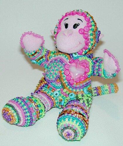 Весёлая обезьянка способна подарить любовь, ведь её сердце страстно пылает.