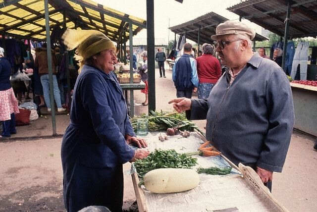 Grocer and Customer at Produce Market in Moscow