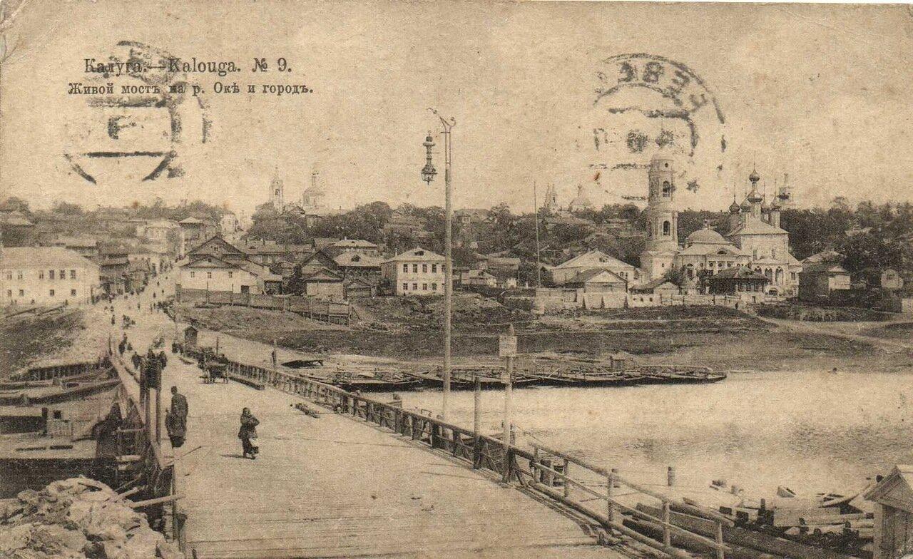 Живой мост на реке Оке и город