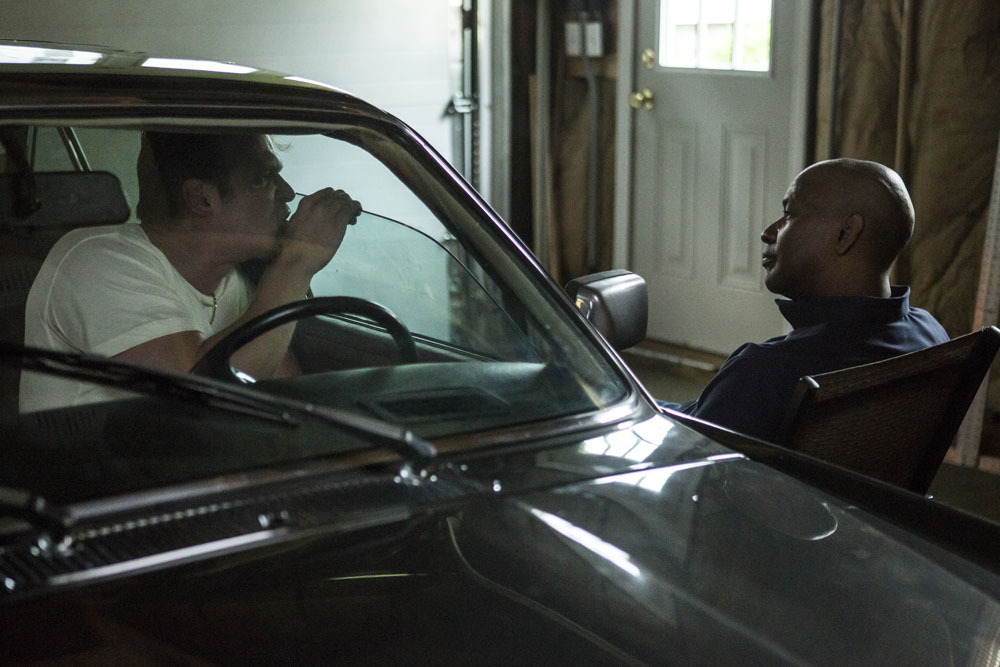 McCall (DENZEL WASHINGTON, right) elicits information from Masters (DAVID HARBOUR) in Columbia Pictures' THE EQUALIZER.