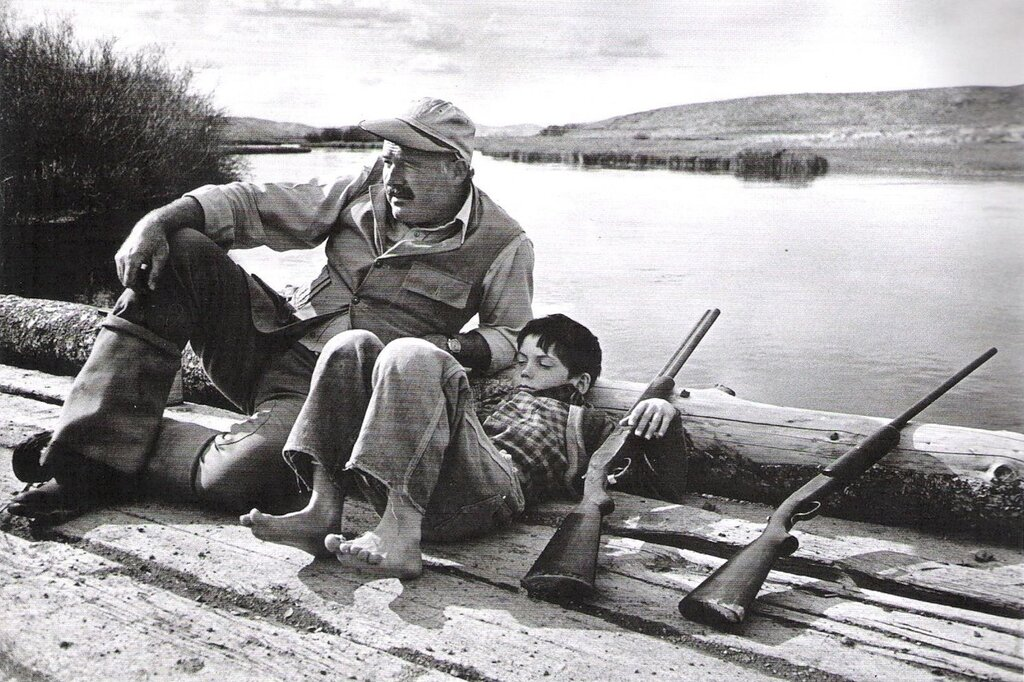 Photographed by Robert Capa.novelist Ernest Hemingway and his son Gregory