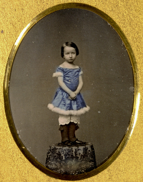 Unidentified girl standing on table