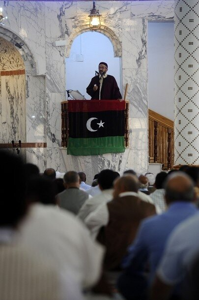 Libyan Muslim men listen to the sheikh a