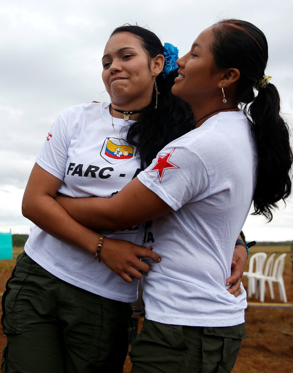 Fighters from Revolutionary Armed Forces of Colombia (FARC), celebrate after opening of ceremony congress at the camp where they prepare for ratifying a peace deal with the government, near El Diamante in Yari Plains, Colombia
