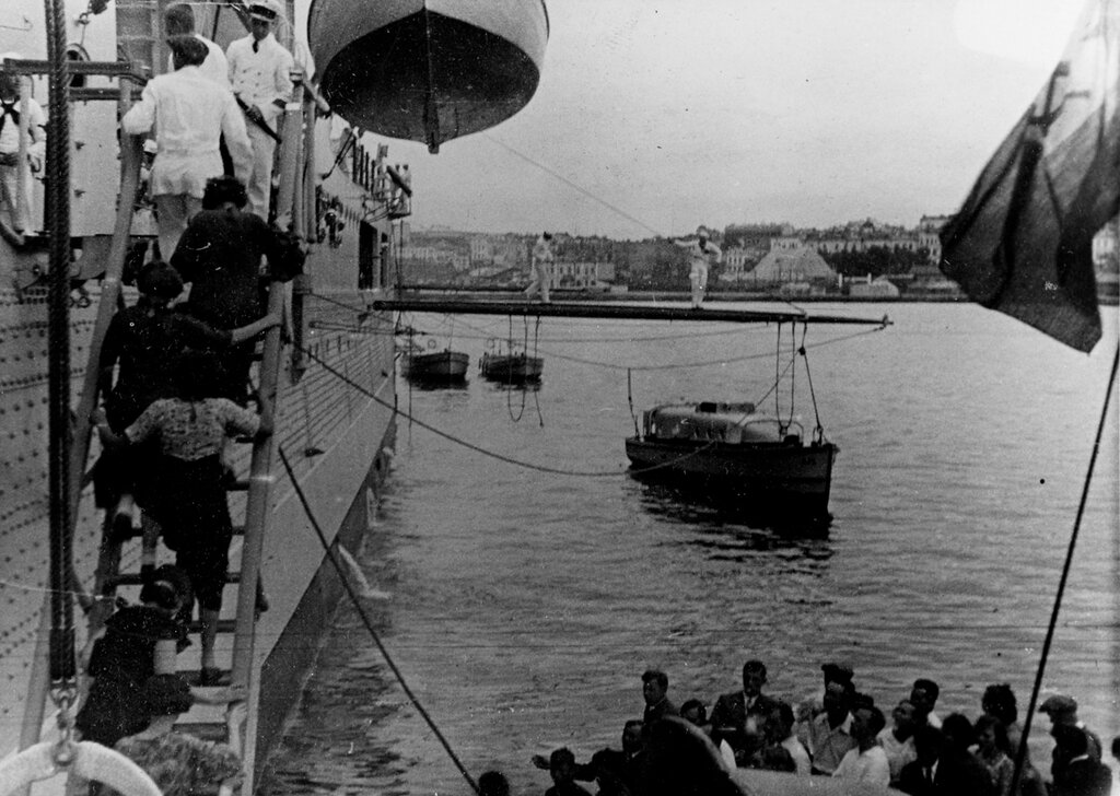 USS AUGUSTA (CA-31). Russian civilians visit the ship while at Vladivostok, USSR, on Saturday, 31 July 1937.