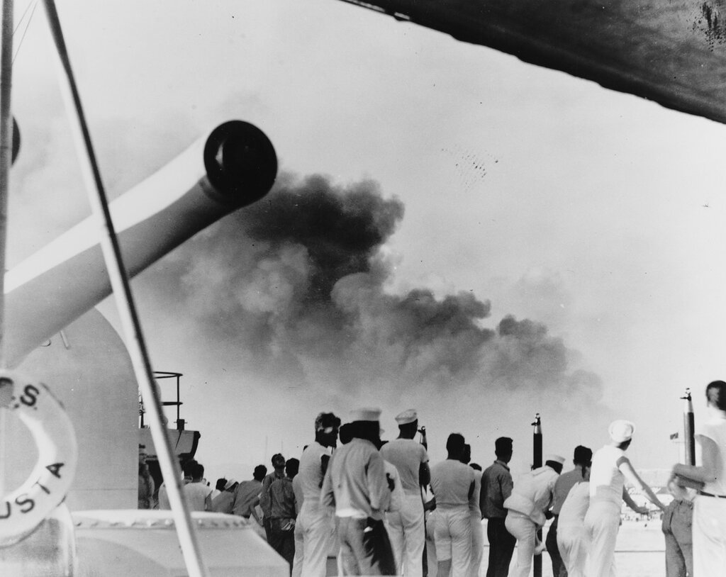 USS AUGUSTA (CA-31) Crew members gather on the starboard side near number three turret to view the Pootung Point fire, circa August 1937, at Shanghai, China.