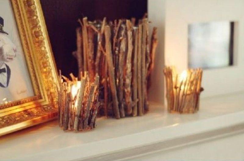 9. Особенным интерьер способны сделать подсвечники и вазы, украшенные тонкими веточками. Они хорошо