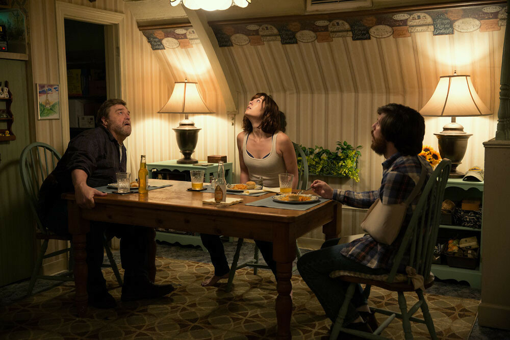 John Goodman as Howard; Mary Elizabeth Winstead as Michelle; and John Gallagher Jr. as Emmett in 10 CLOVERFIELD LANE; by Paramount