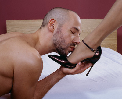 Man Kissing a Woman's Foot