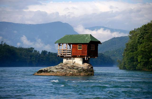 A house built on a rock is seen on the river Drina near Bajina Basta, Serbia. Photo by Marko Djurica