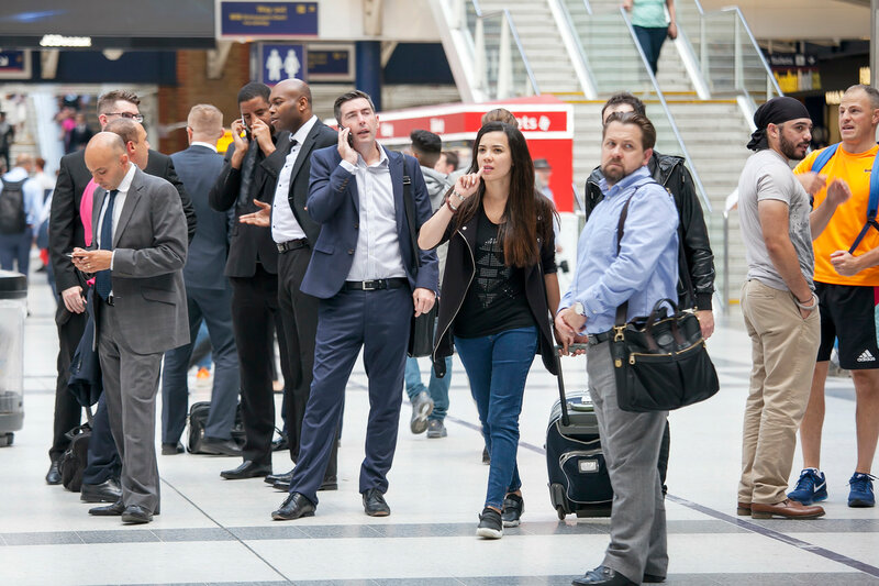 People go through Liverpool Street Station to trains and metro