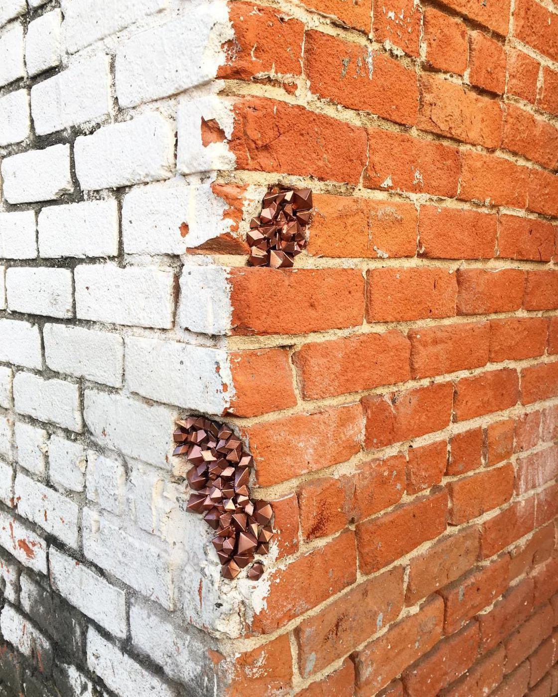 Urban Geode – This street artist fills the holes with colorful crystals