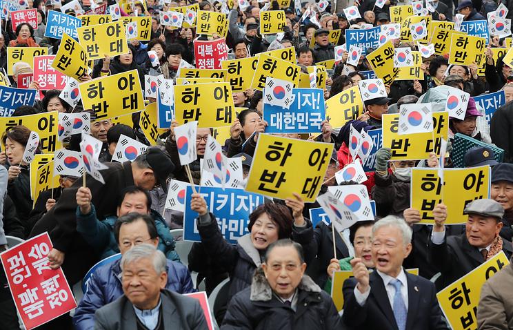 Сотни тыс. людей вышли намитинг заотставку президента Южной Кореи