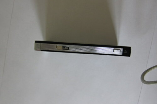 Кнопка камеры и шторка для карты памяти