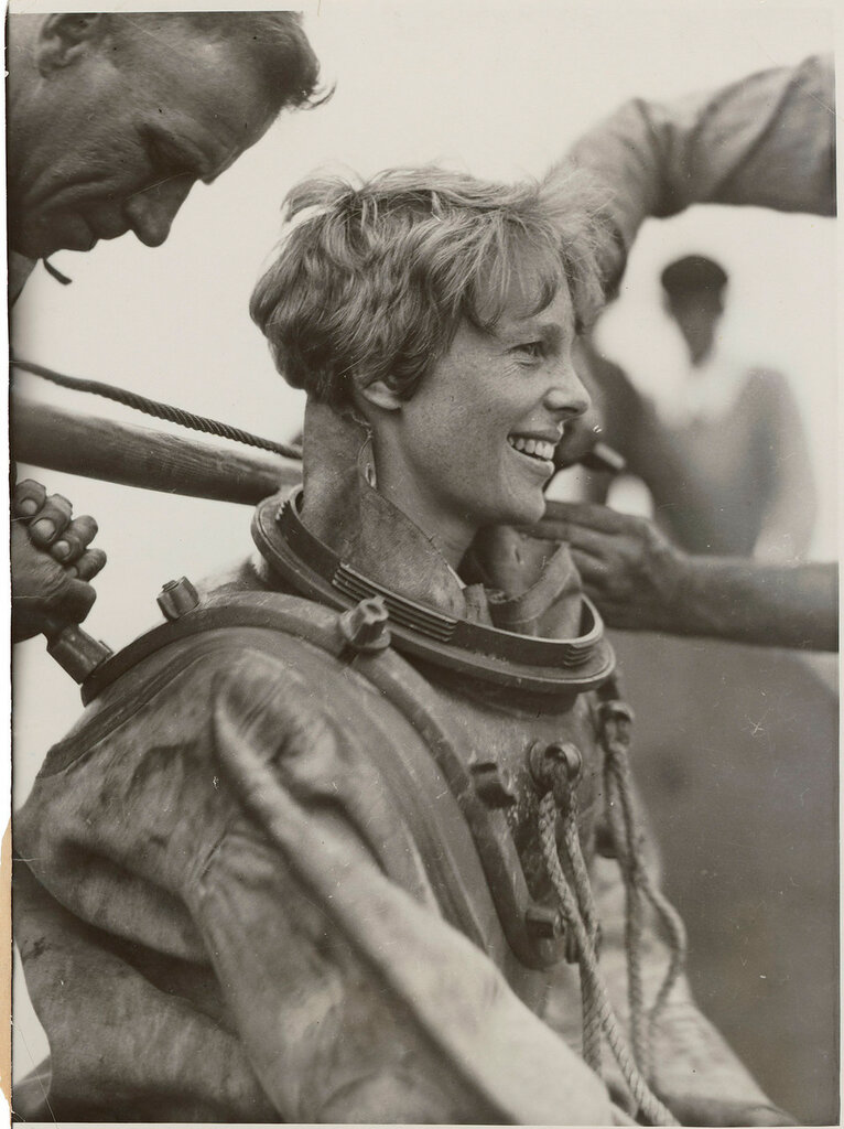 Amelia Earhart helped out of her deep sea diving suit after exploring the bottom of the sea off Block Island, Rhode Island. July 25, 1929.jpg