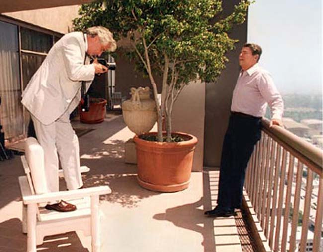 President Ronald Reagan poses for Life photographer Harry Benson on the balcony of the Ronald Reagan Suite, Century Plaza Hotel, August 28, 1987.