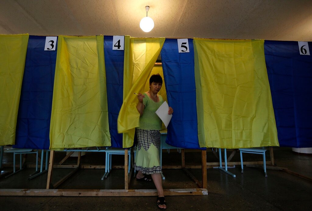 An Ukrainian woman exits a polling booth in the town of Krasnoarmeisk