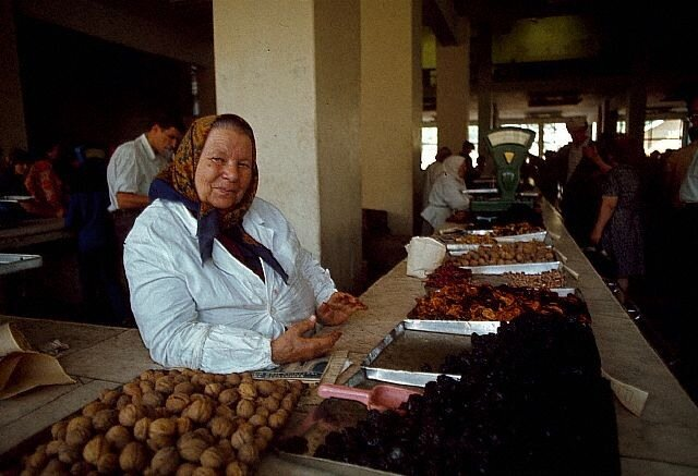 Woman Selling Nuts and Dried Fruit at Market