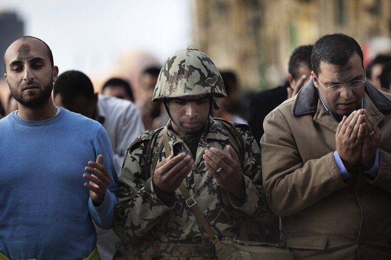 An Egyptian army soldier joins a crowd o