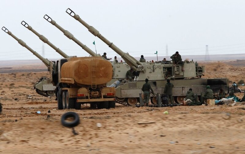 Libyan government soldiers man the artillery gun at the west gate of town Ajdabiyah