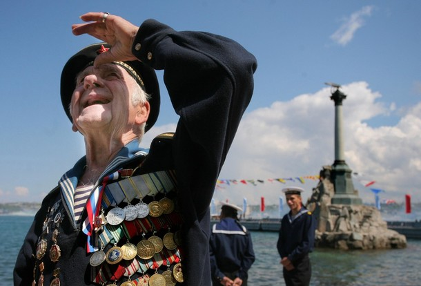 A veteran stands during celebrations of