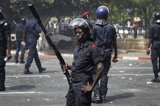 Riot police control an intersection near the National Assembly during a demonstration in Senegal's capital Dakar