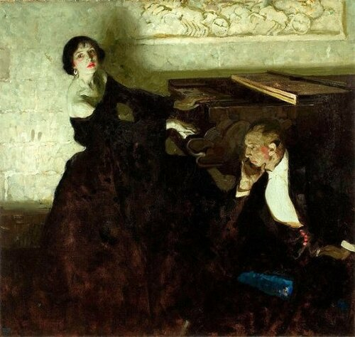 romantic-couple-seated-by-piano.jpg