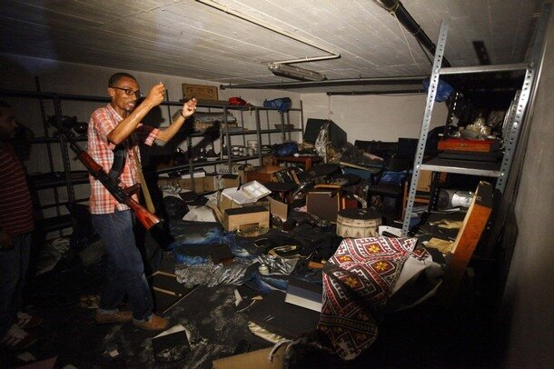 A rebel fighter looks inside the ransacked Bab al-Aziziya compound of ousted Libyan leader Muammar Gaddafi in Tripoli