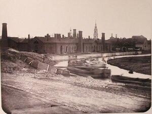 Вид зданий на территории Адмиралтейских Ижорских заводов (слева направо) Большой прокатный завод, [железо]котельная [мастерская].