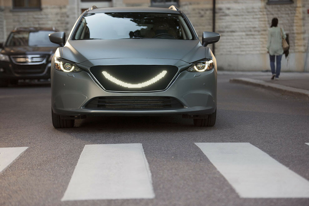 07-When-the-self-driving-car's-sensors-detect-a-pedestrian-a-smile-lights-up-at-the-front-of-the-car-and-the-car-stops.jpg
