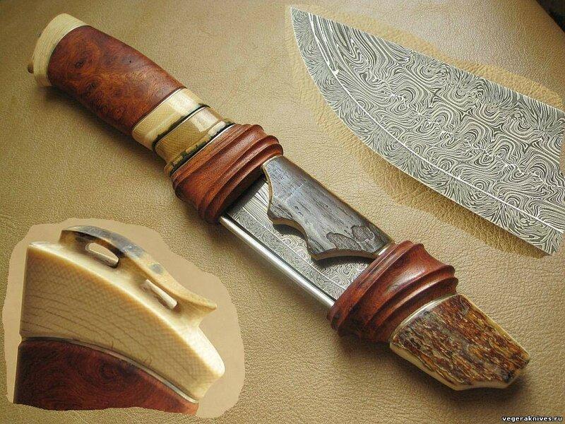 Нож украшенный. Клинок - углеродистый дамаск,кузнец И.Игин (Москва). Рукоять - бивень мамонта, древесина кап кевазинго. Ножны - бивень мамонта,кап кевазинго.