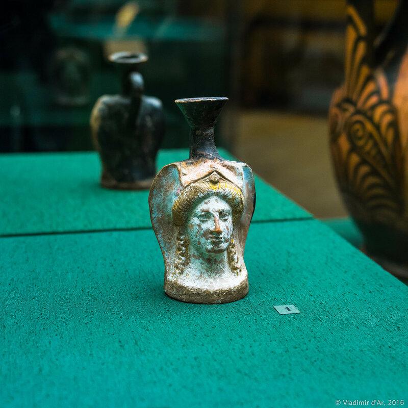 Фигурный сосуд - лекиф в виде головы девушки в головном уборе. Аттика. IV в. до н.э. Керчь.