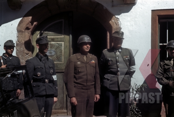 stock-photo-ss-general-max-simon-surrendering-to-american-101st-airborne-division-general-maxwell-d-taylor-schwendt-austria-1945-12783.jpg