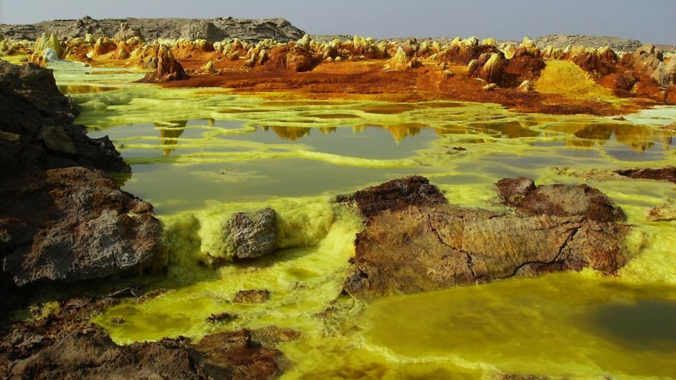 Yellow Lake / Achilli Family / Danakil Depression in Ethiopia is a vast desert basin, characterized