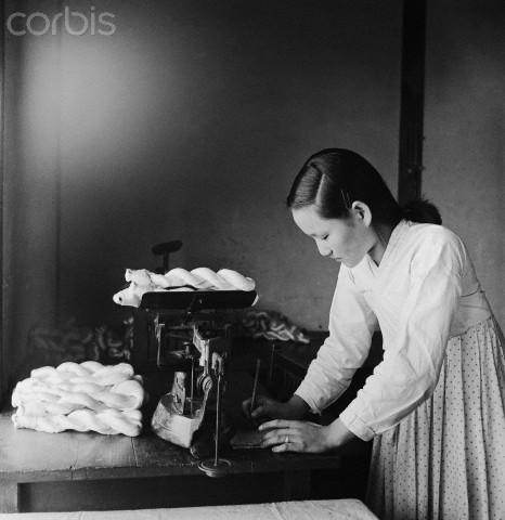 Girl Weighing Skeins of Silk Thread