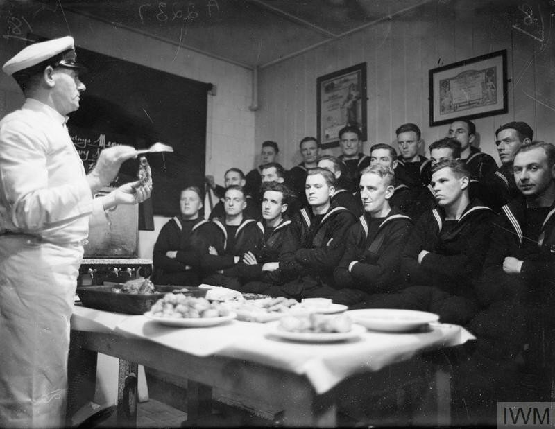 SCHOOL FOR NAVAL COOKS. 1940 ROYAL NAVAL BARRACKS, CHATHAM. AT THE COOKERY SCHOOL MEN ARE TRAINED TO SERVE AS COOKS IN ALL SHIPS IN THE NAVY FROM TRAWLERS TO BATTLESHIPS.