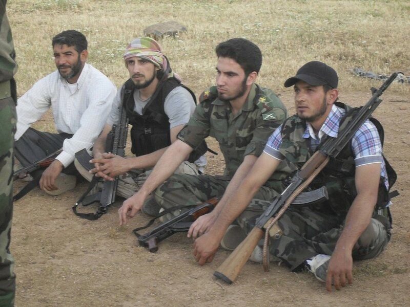 Free Syrian Army fighters attend daily training before commencing patrolling and frontline duties in the countryside of Homs