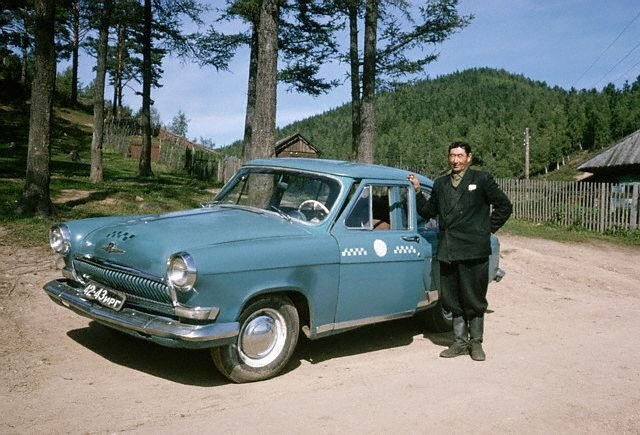 Taxi Driver With His Volga Sedan