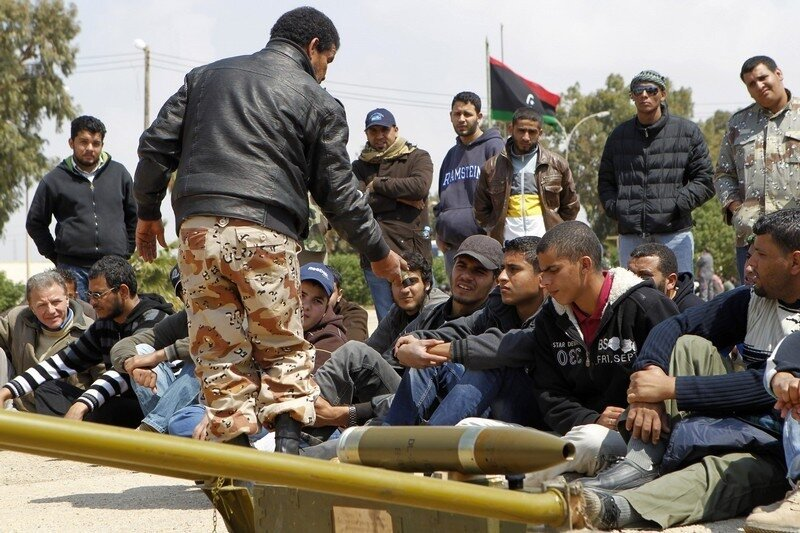 New volunteer rebel fighters receive training on how to use a mortar at a military camp in Benghazi