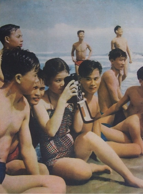 Girl with camera, from the magazine Vietnam Pictorial.jpg