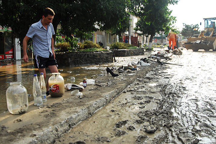 A man walks in a flooded street in Krymsk