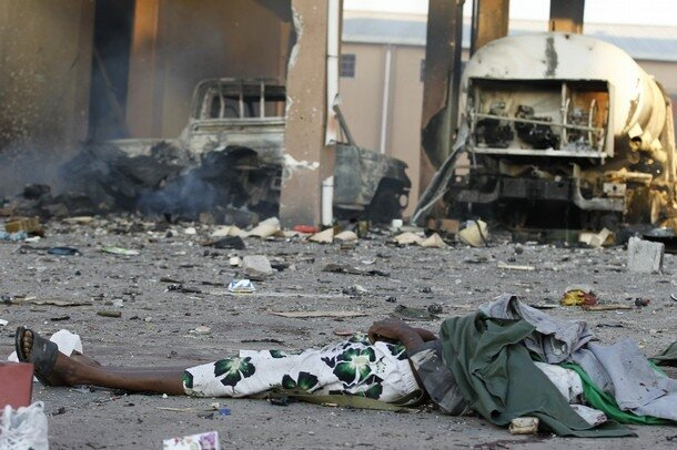 The body of a soldier loyal to Muammar Gaddafi is seen during a fight for the rebel's final push to flush out Gaddafi's forces in Abu Salim district in Tripoli