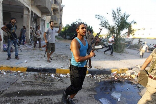 Libyan rebel fighters fight for the final push to flush out Muammar Gaddafi's forces in Abu Salim district in Tripoli