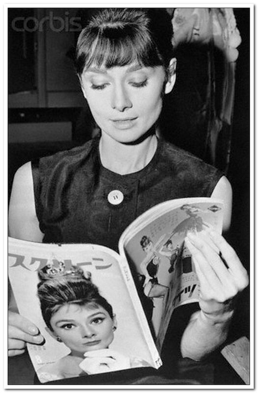 Audrey Hepburn Holding Japanese Magazine with Her Picture
